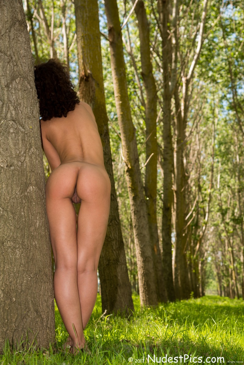 Nudist Gal's Behind in the Tall Woods