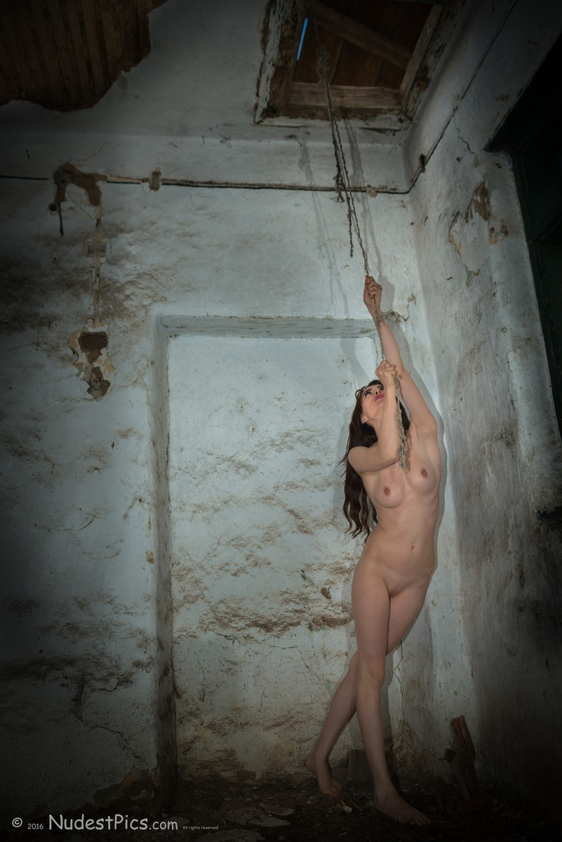 Naked Girl Pulling Rope of Bombarded House