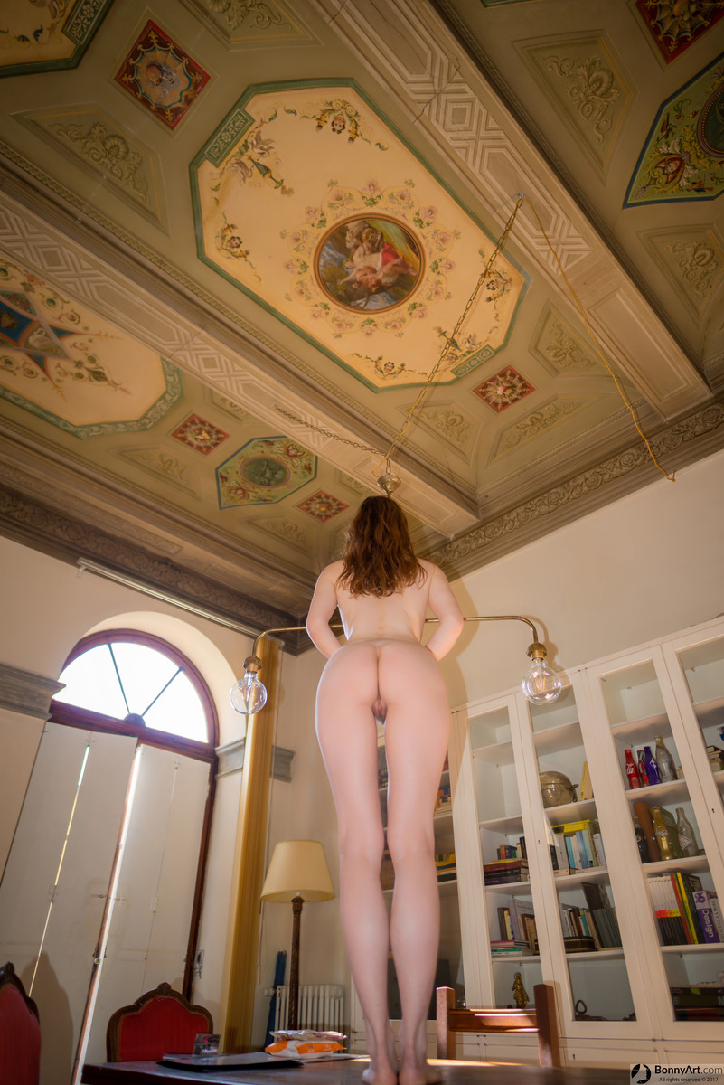 Nude Woman Bending Over in Museum House