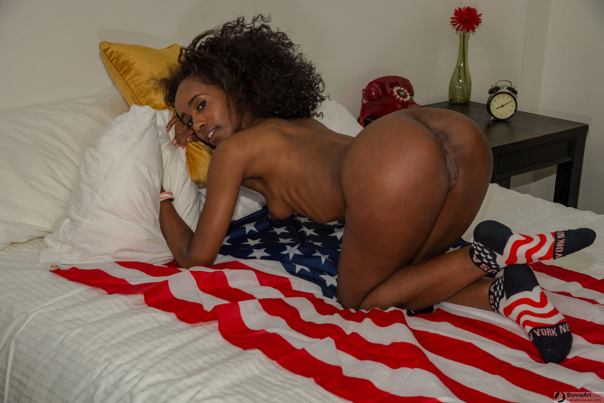 Brown Afro Girl Nude on all fours Sideways Ass & Pussy