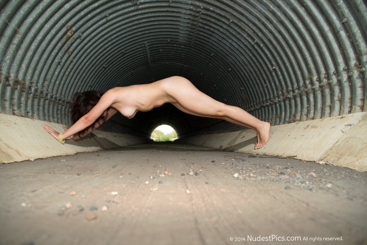 Nude Sportive Girl On All Fours in Tunnel